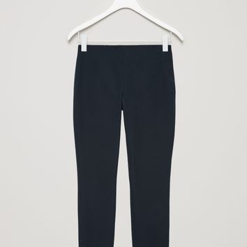 Slim-fit trousers - Black - Trousers - COS US