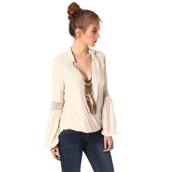 Beige blouse with wrap front and draped detail