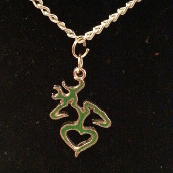 Green browning buck and doe back to back heart style necklace, earrings, key ring, set jewelry