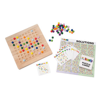 Colorku | A colorful spin on Japanese logic puzzles, this wooden board uses marbles instead of numbers to solve each game.