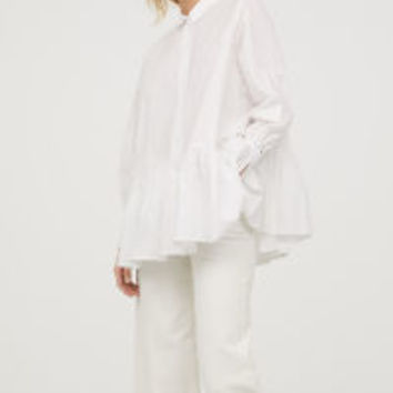 H&M Blouse with Flounced Hem $29.99
