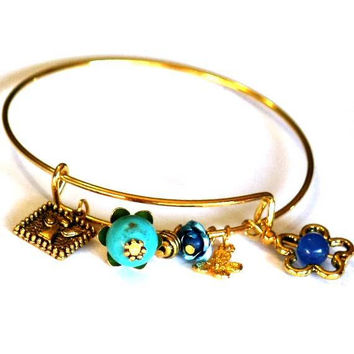Adjustable Golden tone Charm Bracelet - Flowers and Angel - Blue and Gold - Expandable Bracelet in Gold tone Anniversary gift idea Blue rose