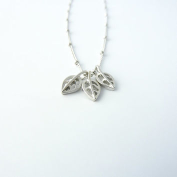 White gold necklace with leaf charms | Tiny leaf necklace, Minimalist jewelry