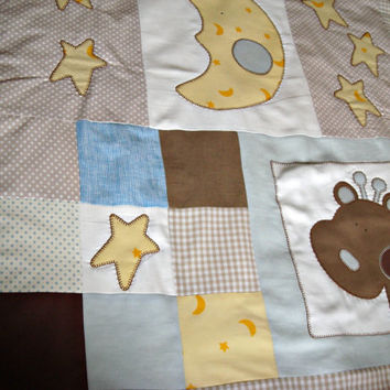 Patchwork baby blanket in white, beige and light blue with appliques. Newborn blanket.