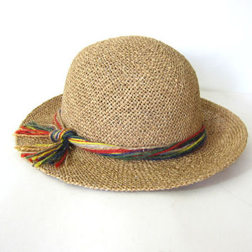 vintage womens brim hat. straw sun Hat. Woven raffia with colorful yarn band