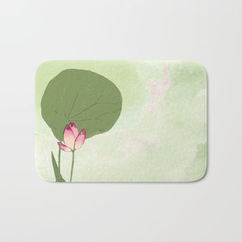 Survive like a lotus flower, rising from the muc Bath Mat by anipani