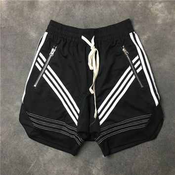 2018 Top quality Justin Bieber Kanye West FEAR OF GOD Oblique stripe Pocket zipper Men shorts Hip hop drawstring sweat shorts