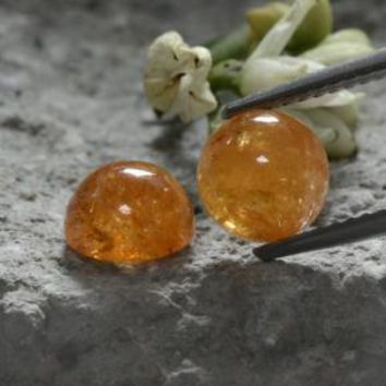 4.44 ct (total) Round Cabochon Orange Spessartite Garnet 6.7 mm