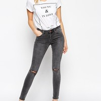 ASOS | ASOS Lisbon Skinny Mid Rise Jeans in Slick Gray Wash with Ripped Knees at ASOS