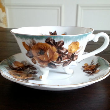 Antique Lefton China yellow rose footed tea cup and saucer set