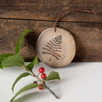 Wood Burned Fern Frond Ornament. Rustic wooden pine ornament with fern leaf design.