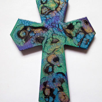 Decorative Cross hand painted in a rainbow of colors of blue, green, purple, black and gold
