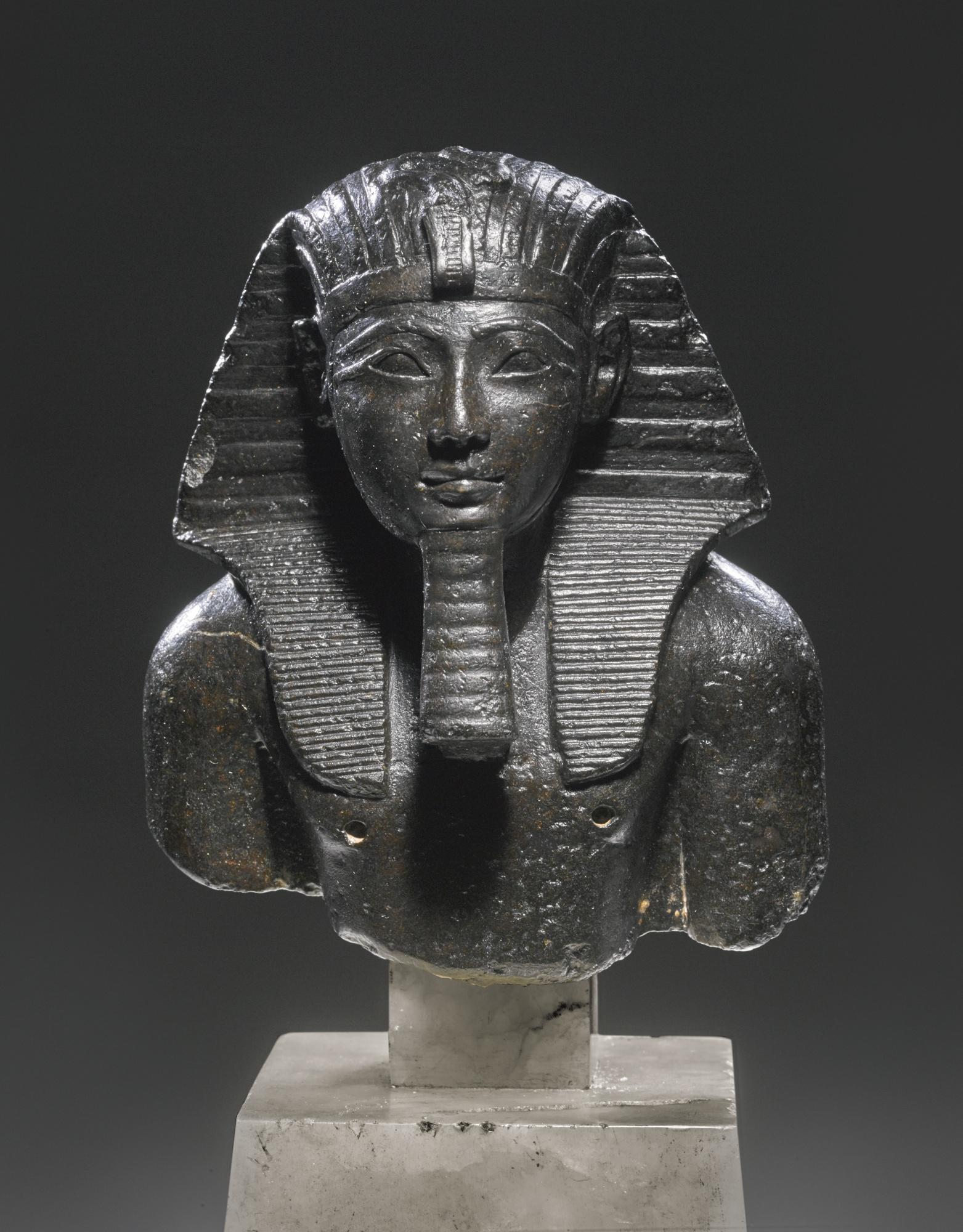 An egyptian basalt bust of tuthmosis iii from sothebys