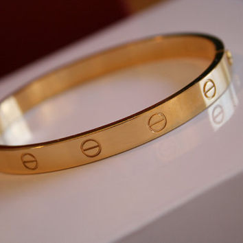 Beautiful kardashian Yellow Gold screw bracelet aka ladies love bangle - with screw engraved detail around the bracelet