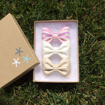 Pink striped, tan striped, and pale off white hair bows from Seaside Sparrow.  Seaside Sparrow bows make the perfect birthday gift.