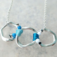 Spring 2014 Collection Silver Ring Necklace with Blue Tone Cords