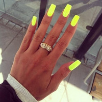 Neon yellow nails - image #1471413 by nastty on Favim.com