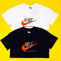 NIKE Couple T-shirt Nike color embroidery logo short-sleeved casual sports round neck Black/White
