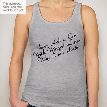 Never Ask A Girl with Winged Liner Jersey tank available in White & Gray. Available in Junior sizes. Makeup Artist in all of us!