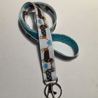 dachshund Lanyard  ID Badge Holder -  kissing dachshunds with white pin polka dots on blue- Lobster clasp and key ring