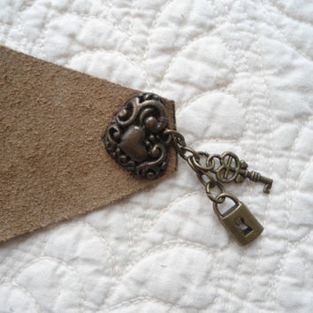 Brown Leather/Suede Cuff Bracelet Pendant is a Deer with a stone on his head 2 charms and a charm covering the snap closure