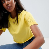 ASOS DESIGN crop t-shirt with roll sleeve and raw hem at asos.com