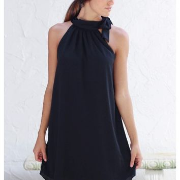 Elegant black halter dress with neck bow detail | Cricket | escloset.com