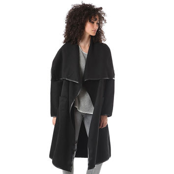 Black duster coat with wide notch lapels