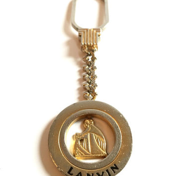LANVIN!!! Vintage 1970s 'Lanvin' gold and silver circular keyring with enamelled logo and cast emblem || Made in Italy