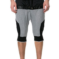 The S.Q.Z. Solid Cotton French Terry Drop Crotch Short Pants with Mesh & Faux Leather Trim.