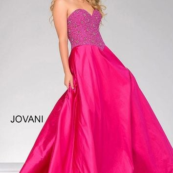 Fuchsia ballgown with a strapless sweetheart neckline and a silk skirt.
