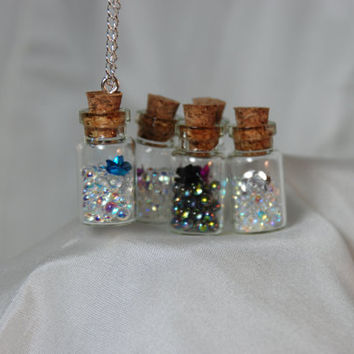 Tiny Glass Bottles filled with Iridescent Bubbles and by ImageLove
