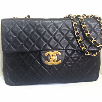 Vintage CHANEL black lamb leather extra large, jumbo size shoulder bag with big golden CC closure and chain strap. 2.55 classic purse. Best