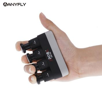 Professional Aroma Hand Finger Exerciser Medium Tension Hand Grip Trainer+ 1 Gift Pick for Guitar Bass Piano Black