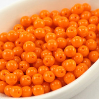 4mm beads. Opaque orange round glass. 100pc Czech druk.NR 2