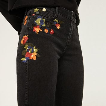 MID RISE EMBROIDERED SKINNY JEANS