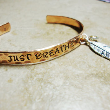 Just breathe copper cuff with silver feather charm and crystal charm