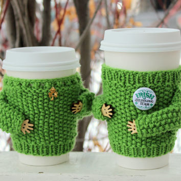 Pair of St. Patrick's Day cup sweaters Shamrock charm Emerald rhinestone Coffee cozy Knit cup sleeve Green wool Eco-friendly Starbucks cup
