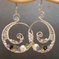 Luxe Bijoux 77 Hammered swirl shapes wrapped with ivory pearls, amethyst, tanzanite, and vessonite