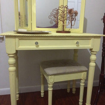 Yellow Vanity with tri-fold mirror and bench.