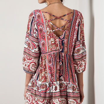 This effortless dress features parsley pattern print on blended fabric, low scoop neckline, three quarter sleeve with elastic design, plunging v-neckline back cutout with criss-cross detailing. Unlined.