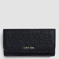 perforated monogram trifold mega continental wallet | Calvin Klein