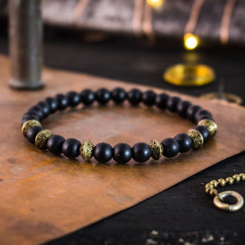 Matte black onyx beaded stretchy bracelet with bronze accents, made to order yoga bracelet, mens bracelet, womens bracelet