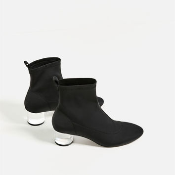 ANKLE BOOTS WITH METHACRYLATE HEEL DETAILS