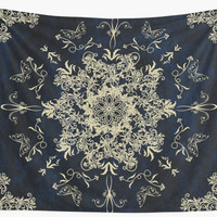 'Pale Gold Floral Design On A Textured Blue Background' Wall Tapestry by ImageMonkey