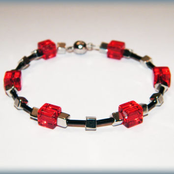 Red cube bracelet .. Red, black and silver beads with a magnetic clasp