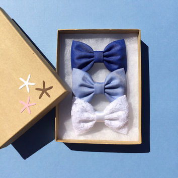 Beautiful blues and white lace hair bows from seaside sparrow.  The perfect gift for her this spring and summer.