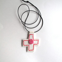 Hand embroidered pendant in hot pink with hot pink glass bead embellishment on cream muslin with a black leather cord An Astrid Endeavor