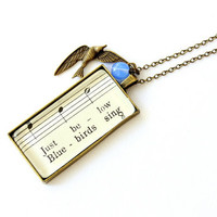 Boho charm necklace with vintage sheet music, bird charm, blue bead.  Vintage style unique long necklace.