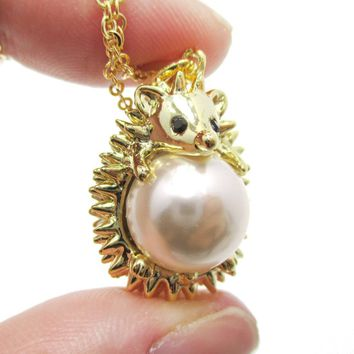 Hedgehog Porcupine Hugging a Pearl Shaped Animal Pendant Necklace in Gold